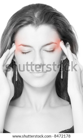 woman with headache holding her hands to the head - stock photo
