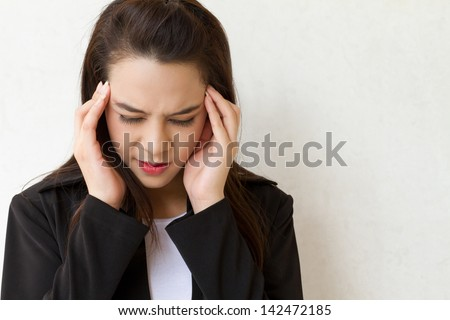 woman with headache, migraine, stress, insomnia, hangover in business executive dress