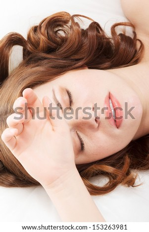 Woman with headache, migraine, stress, insomnia or hangover in bed - stock photo