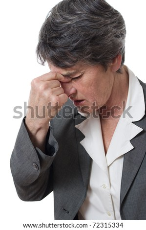woman with headache pinching her nose isolated over white - stock photo