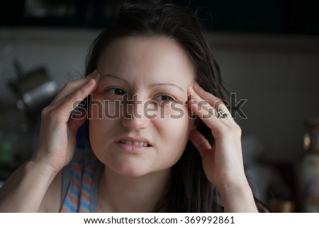 Woman with headache. Woman face with pain grimace - stock photo