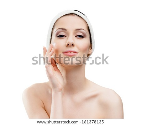 Woman with headband making face moistening procedures, isolated on white - stock photo