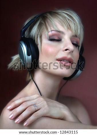 Woman with headphone listening music - stock photo