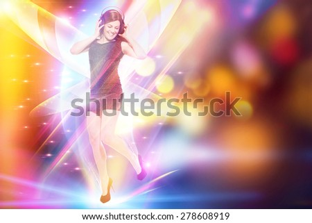 Woman with headphones is dancing over colorful background - stock photo