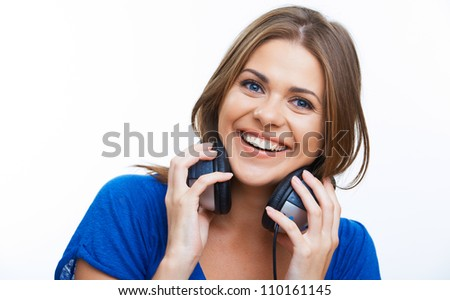 Woman with headphones listening music .Music teenager girl close up face portrait . - stock photo