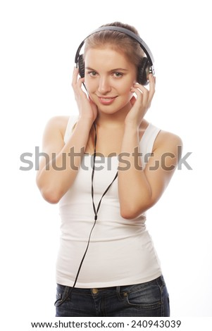 Woman with headphones listening music . Music teenager girl isolated on white. - stock photo