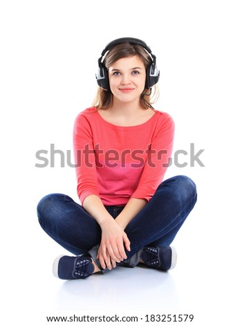 Woman with headphones listening music on player. Music teenager girl close up portrait against isolated white background