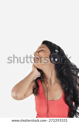 Woman with headphones listening to music - stock photo