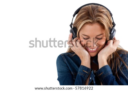 Woman with headphones listening to music - isolated over a white background - stock photo