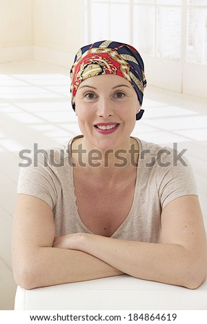 woman with headscarf after cancer treatment - stock photo
