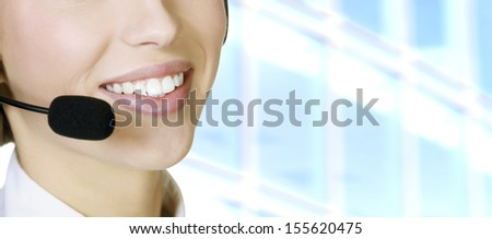 Woman with headset, corporate background - stock photo