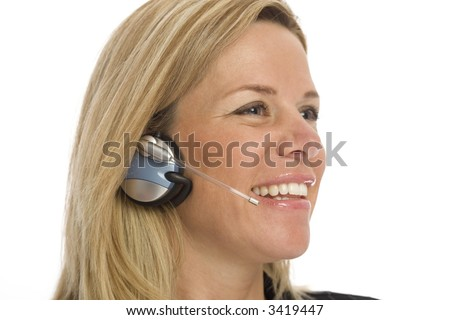 Woman with headset smiles against a white background