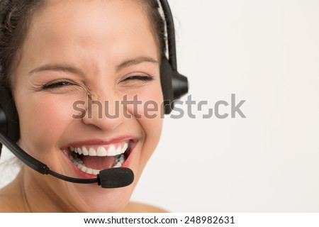 Woman with headset smiling,