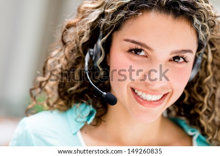 Woman with headset working at a call center  - stock photo