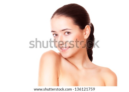 woman with healthy clean skin looking at camera - stock photo