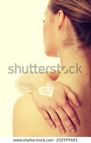 Woman with heart shape cream on hand. Isolated on white.