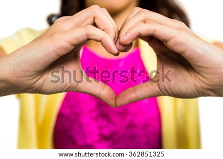Woman with heart shape made from fingers - stock photo