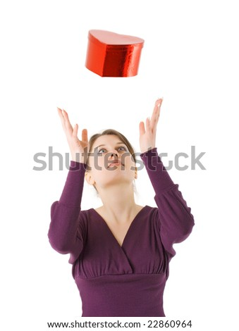 woman with heart shaped gift box for Valentines day - stock photo