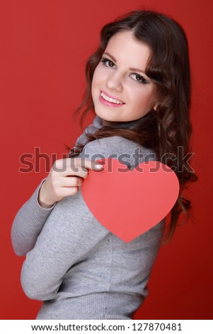 Woman with heart symbol on Holiday theme - stock photo