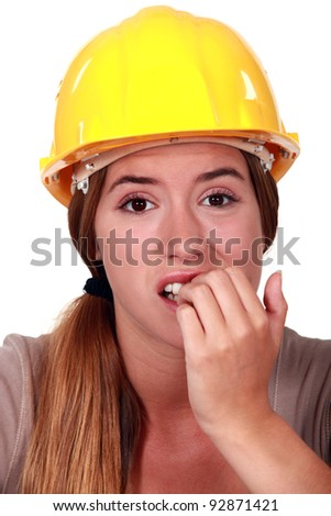 Woman with helmet biting her nails