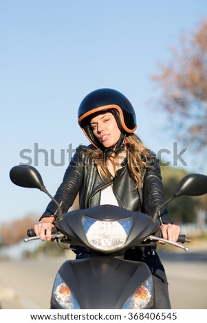 Woman with helmet on scooter