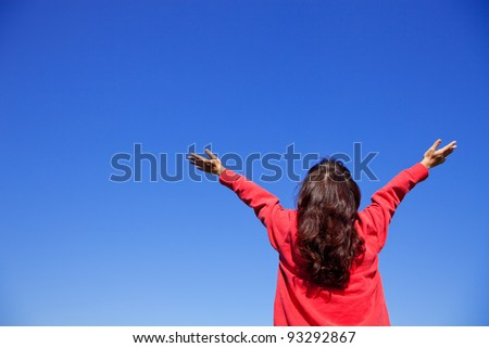 Woman with her arms wide open - stock photo