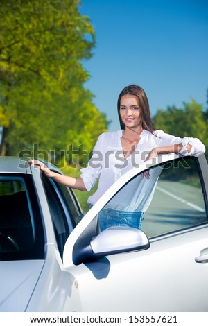 Woman with her car outdoors
