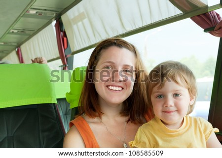 woman with her child in bus cabin