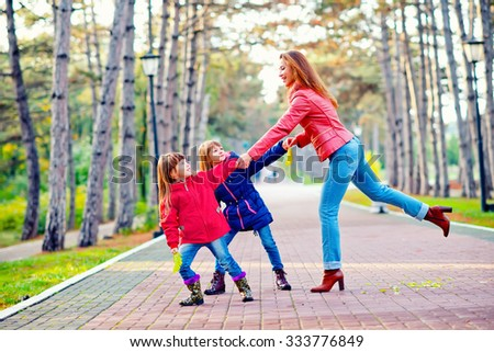 woman with her childrens in park