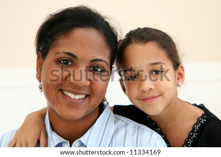 Woman with her daughter - stock photo