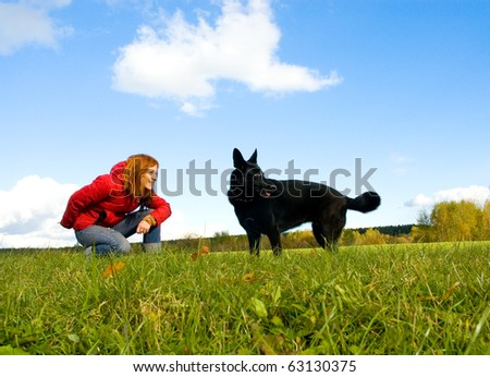 woman with her dog on meadow. - stock photo