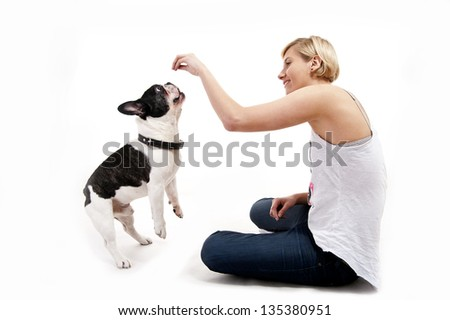 Woman with her dog playing - stock photo