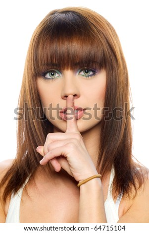 Woman with her finger on lips