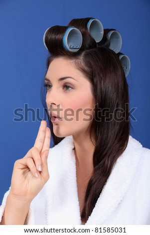 Woman with her hair in large Velcro rollers - stock photo