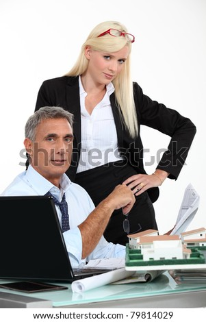 Woman with her hands on her hips standing in an architect's office - stock photo