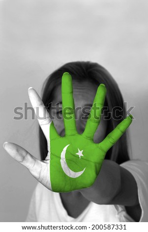 woman with her hands signaling to stop and Pakistan flag - stock photo
