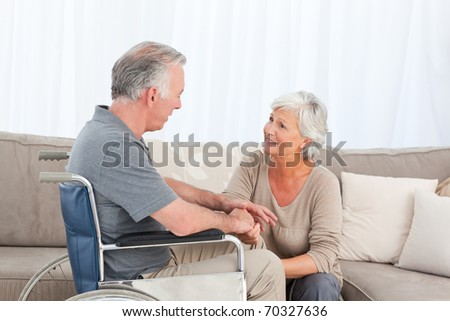 Woman with her husband in a wheelchair