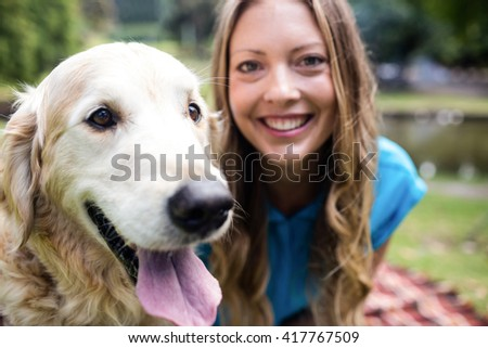 Woman with her pet dog in the park