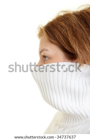 Woman with her turtleneck sweater up to her nose - stock photo