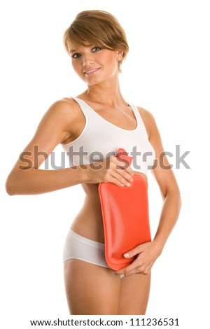 Woman with hot water bottle - stock photo