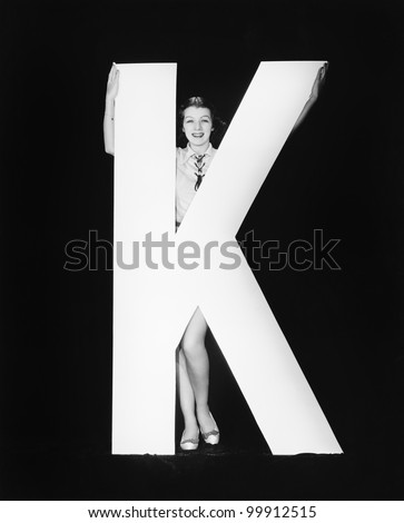 Woman with huge letter K - stock photo