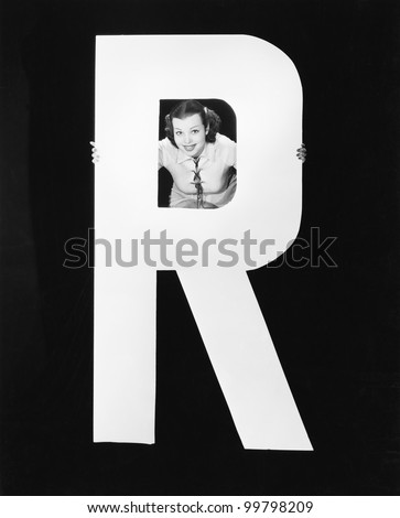 Woman with huge letter R - stock photo