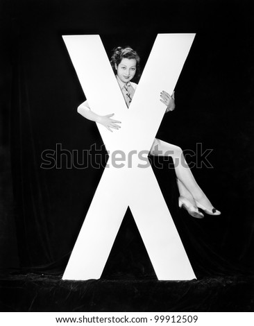Woman with huge letter X - stock photo