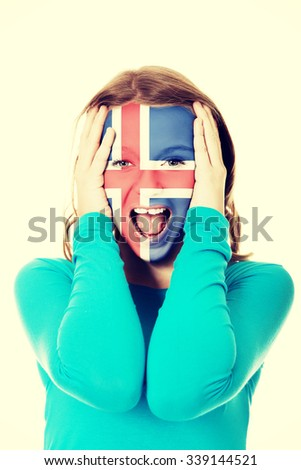 Woman with Iceland flag painted on face. - stock photo