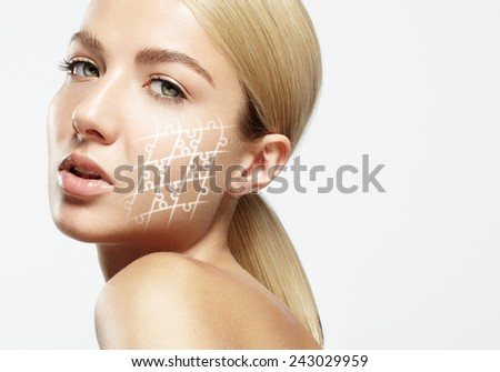 woman with ideal skin and glowing puzzle - stock photo