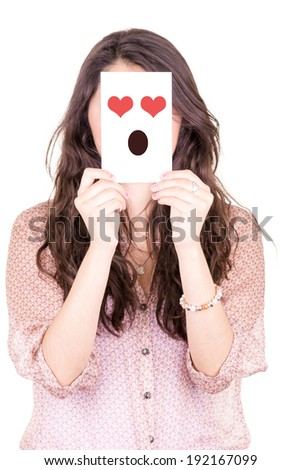 woman with in love emoticon on a paper in her face