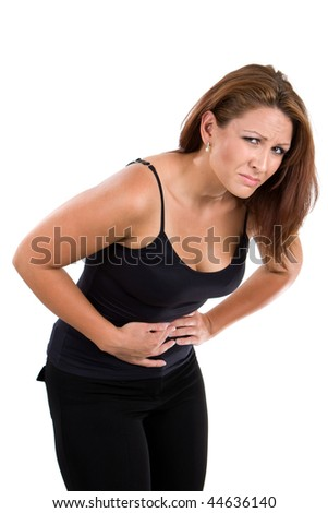 Woman with indigestion bends over in obvious agony. - stock photo