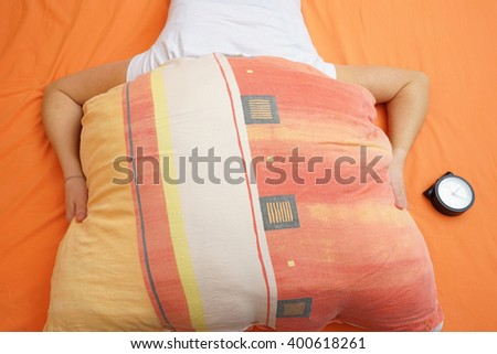 woman with insomnia, female holding pillow over head