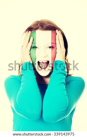 Woman with Italian flag painted on face. - stock photo