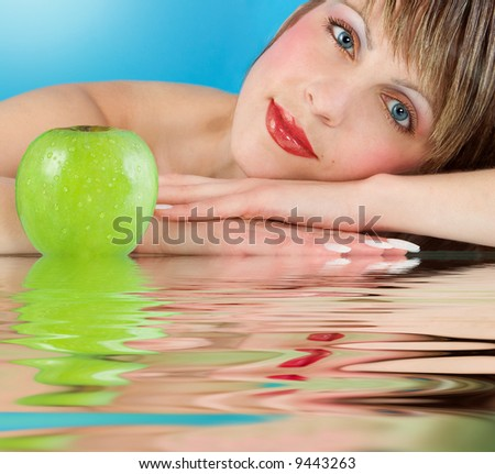 Woman  with juicy green apple - stock photo